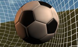 Ball of football against network of desk Royalty Free Stock Image