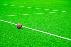 Ball on a football pitch with white stripes Stock Photo