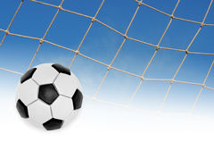 The ball and a fragment of a football goal nets Stock Photos