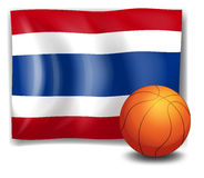 A ball in front of the flag of Thailand Stock Photography