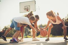 The ball is for fun and play. Family playing basketball stock images