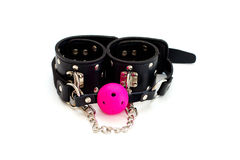 Ball gag and leather handcuffs. Ball gag and leather cuffs for role-playing games Royalty Free Stock Photography