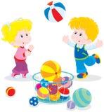 Ball game. Girl and boy playing a big colorful ball Royalty Free Stock Photography