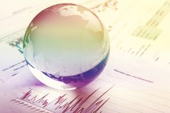Glass globe ball on business report background Royalty Free Stock Photos