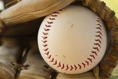 Ball in glove. Baseball inside a baseball glove Stock Photo
