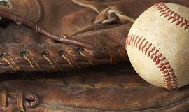 Ball and glove. A macro of a baseball in glove Royalty Free Stock Photos