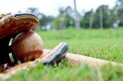 Ball in glove with baseball bat stock photo