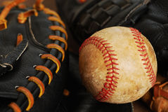 Ball and gloves Stock Images