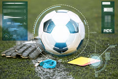 Ball, gloves, whistle and cards on soccer field Stock Image