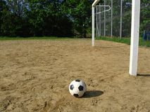 Ball and goal. On the sand playing field Stock Image