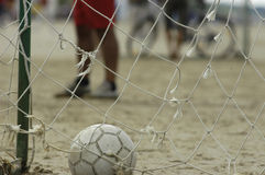 Ball in goal. Ball is lying in the goal, soccer at the beach Royalty Free Stock Images