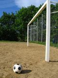 Ball and goal. On the sand playing field Stock Images