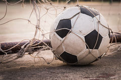 Ball in the goal net Royalty Free Stock Image