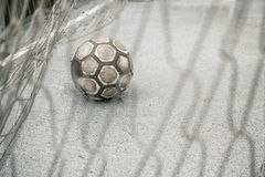 Ball in a goal Stock Images