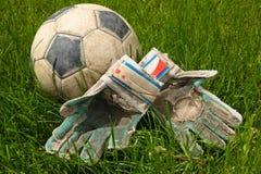Ball goalkeeper sportswear and football on grass
