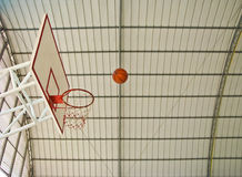 A ball going to basketball hoop Royalty Free Stock Photography