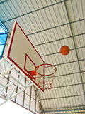 A ball going to basketball hoop Stock Image