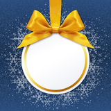 Ball with golden satin ribbon bow on blue background. Christmas ball with golden satin ribbon bow on blue background Stock Images