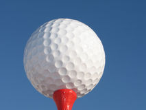 Ball for a golf. On a background of the blue sky Stock Photo