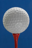 Ball for a golf. On a dark blue background Stock Images