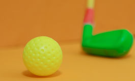 Ball golf for children. With blur golf club Royalty Free Stock Images