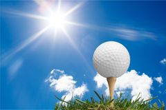 Golf ball on tee  on green grass Stock Images
