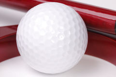 Ball for golf in hole. White ball for golf in red wooden red hole, office set Stock Images