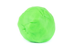 Ball of green ball of play doh. A single ball green ball of play doh modeling clay over white stock photos