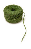 Ball of green garden twine. Isolated against a white studio background Royalty Free Stock Photos