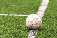 Ball on the green grass of a football field.  royalty free stock image