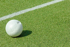 Ball on green synthetic grass sports field Stock Photo