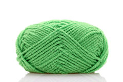 Ball of green wool. Isolated on white background royalty free stock photos