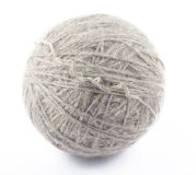 Ball of grey wool on white. Background Stock Photography
