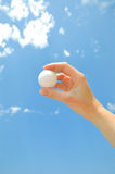 Ball on hand Royalty Free Stock Image