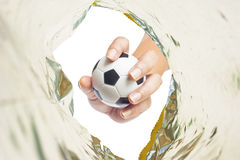 Ball on Hand in plastic Stock Images