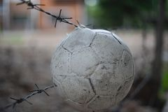 Ball hang on barrier in front of abandon place royalty free stock photos