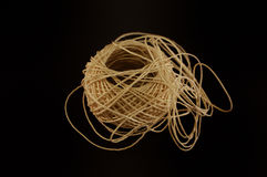 Ball of hemp cord. A tangled ball of hemp cord over a black background royalty free stock photo