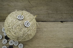 Ball of hemp rope, needle and buttons Royalty Free Stock Photography
