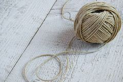 Ball of hemp twine on white wooden background with space for text stock photos