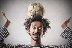 With a ball on his head Stock Photo