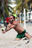 Ball Hits Lunging Player's Arms In Miami Beach Volleyball Game Royalty Free Stock Photos