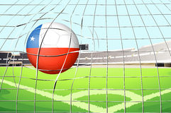 A ball hitting a goal with the flag of Chile Royalty Free Stock Photos