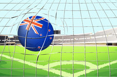 A ball hitting a goal with the New Zealand flag Royalty Free Stock Photo