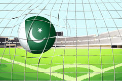 A ball hitting a goal with the Pakistan flag Stock Photo
