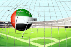 A ball hitting a goal with the UAE flag Stock Image