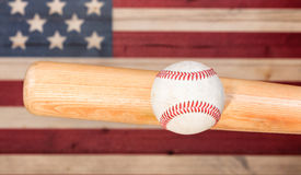 Ball hitting wooden bat with faded boards painted in American US Royalty Free Stock Photos