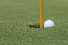 Ball in the hole Royalty Free Stock Image