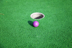 Ball into the hole Stock Photography