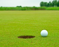 Ball and hole Royalty Free Stock Images