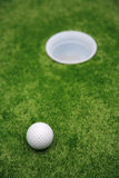 Ball and hole Stock Photos